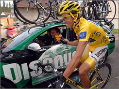 Alberto Contador, winner of this year's Tour de France, pedals alongside his team support car, driven by manager Johan Bruyneel, during the final leg of the race.