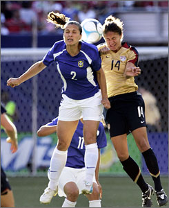 Stephanie Lopez, right, goes up for a header during the USA's game against Brazil in June.