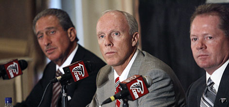 Michael Vick's indictment in a federal dogfighting investigation has turned the Atlanta Falcons organization upside down. Owner Arthur Blank, left, was prepared to suspend the quarterback before commissioner Roger Goodell ordered him not to report to training camp, leaving rookie coach Bobby Petrino, right, without his starting quarterback.