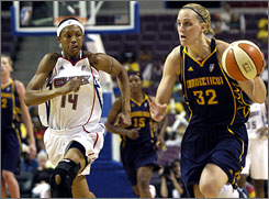 Katie Douglas, left, tries to outrun fellow 2001 draft pick Deanna Nolan. Of the top 13 scorers in the WNBA, six of them were drafted in 2001.