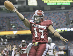 Troy's Omar Haugabook celebrates scoring a touchdown against Rice in the New Orleans Bowl last December. The Trojans won 41-17 as Haugabook capped a season in which he won the Sun Belt's MVP award.