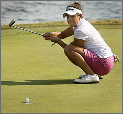 Maria Jose Uribe reacts as her putt drops into the cup on the 18th hole to give her the victory at the 2007 U.S. Women's Amateur Championship.