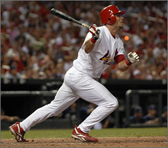 Rick Ankiel rocks a three-run homer against the Padres last Thursday during his return to the Cardinals as an outfielder.