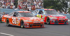 Jeff Gordon, right, and Tony Stewart lock horns in a door-to-door battle at Watkins Glen. Stewart won the round, but the season-long campaign between the two could be a toss-up.