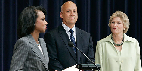 Secretary of State Condoleezza Rice speaks as Hall of Famer Cal Ripken Jr. and Department of State official Karen Hughes look on Monday. The government has named Ripken an international sports envoy.