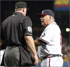This discussion over a called third strike went poorly for Braves manager Bobby Cox, who was tossed by umpire Ted Barrett to set a big-league record for managerial ejections with No. 132. Cox, who is in his 26th season in the dugout, had been tied with Hall of Famer John McGraw, who did his barking from the late 1890s to the 1930s.