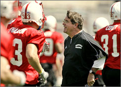 Nebraska head coach Bill Callahan, center, smiles as he talks to some of his players on the Cornhuskers' first day of preseason training camp on Aug. 6. Callahan has increased the team's win total every year since taking over in 2004, and hopes this is the season that Nebraska re-captures a Big 12 title.