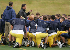 "Head Coach Butch Goncharoff talks with his players at Bellevue High School during a practice session. Goncharoff, who is 81-7 since 2000 and has won five of the past six Washington 3A state titles, loves the deception. ""A good fake is worth two good blocks"" is one of his aphorisms."