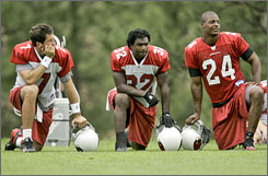Quarterback Matt Leinart, left, running back Edgerrin James, center, and safety Adrian Wilson are three of the cornerstones in new Arizona coach Ken Whisenhunt's team.