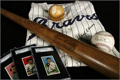 Some of the items to be auctioned by Mastro Auctions include a Hank Aaron 1969 Atlanta Braves signed game worn home jersey, a Mickey Mantle 500th home run ball (darker), a Babe Ruth single signed ball, a Ty Cobb game used bat, and a set of T215 Pirate Cigarette baseball cards.