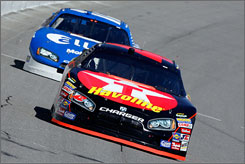 Juan Pablo Montoya drives ahead of Ryan Newman during practice at the Michigan International Speedway on Friday.