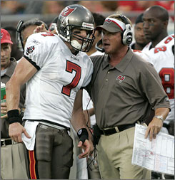 Despite being named the starter before camp began, Jeff Garcia has approached the 2007 NFL season as if he has something to prove. Garcia's attitude has head coach Jon Gruden, right, enamored with the quarterback.