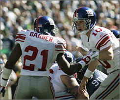 New York Giants quarterback Eli Manning is downplaying his public feud with former teammate Tiki Barber.