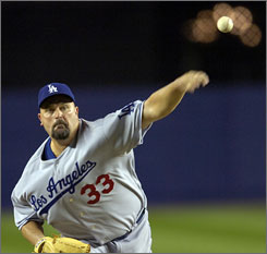 David Wells allowed seven hits and two runs while striking out two batters in his first start with the Dodgers.