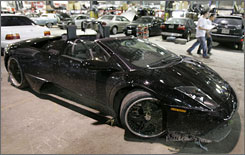 Lance Briggs' black Lamborghini sits in a garage after it was found abandoned on a Chicago-area road early Monday morning.