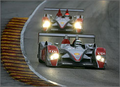 Allan McNish, the co-leader of the American Le Mans Series' top class, sets the pace ahead of Audi teammate Emanuele Pirro at Road America.