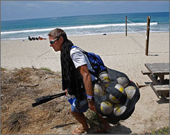 "Carrying his gear, Karch Kiraly heads home after a session on the beach near his home in California. Kiraly, the ""King of the Beach,"" has announced his retirement from volleyball at the end of the AVP season."