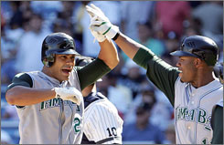 Carlos Pena, left, is welcomed back to the Devil Rays bench after launching a three-run homer in the seventh inning against the Yanks.