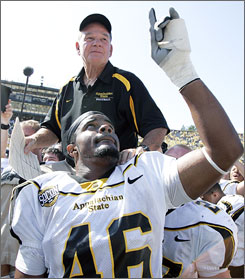 Mountaineers head coach Jerry Moore is carried off the field by Tony Robertson and other teammates after upsetting the fifth-ranked Wolverines 34-32 on Saturday. Moore orchestrated the offensive gameplan that led to one of college football's greatest upsets.