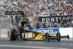 Tony Schumacher hustles his dragster down the quarter-mile at O'Reilly Raceway Park. His top speed of 331.94 mph in the Top Fuel final was his fastest clocking of the day.