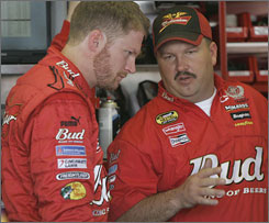 Dale Earnhardt Jr. talks strategy with crew chief Tony Eury Jr., right, during practice at Darlington Raceway this season.