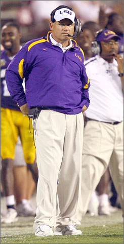LSU coach Les Miles eyes his Tigers as they play Mississippi State last week.