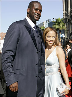 Miami Heat center Shaquille O'Neal and wife Shaunie pose for photographers at the ESPY awards this past July.