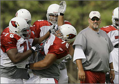 Russ Grimm, right, went to Arizona to join new Cardinals head coach Ken Whisenhunt, with whom he coached during the past six seasons in Pittsburgh.