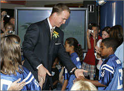 Indianapolis Colts quarterback Peyton Manning is greeted by patients at St. Vincent Children's Hospital before a ceremony that renamed the hospital in his honor.