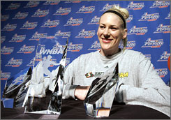 Seattle Storm center Lauren Jackson, shown with her trophy for WNBA Defensive Player of the Year on Aug. 24, has now added a second league MVP award to her haul as well.