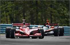 Scott Dixon sets the pace over Dario Franchitti during this season's race at Watkins Glen, N.Y. In the season points race, their roles are reversed  Franchitti clings to a three-point lead with one event left.