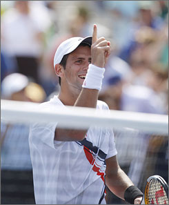 Novak Djokovic reacts to defeating David Ferrer in the first of Saturday's semifinal matches at the U.S. Open.