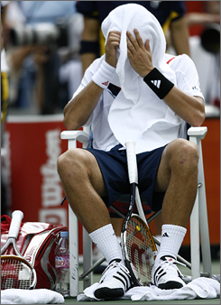 Novak Djokovic takes a breather during his loss to Roger Federer in the U.S. Open final. Djokovic had three set points on his serve in the first set, but Federer rallied for the break and ultimately the set and the match.