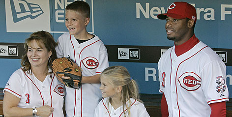 Katrina Morino, whose husband was a firefighter who perished during the World Trade Center collapse on 9/11, visited Ken Griffey Jr. in the Great American Ball Park dugout on Tuesday. Tyler and Kristin Morino joined their mom and Junior before the Reds played the St. Louis Cardinals.