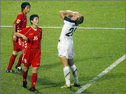 Abby Wambach can't believe she missed the net against North Korea. The teams drew 2-2 in their Women's World Cup opener.