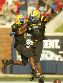Miami Northwestern's Tommy Streeter (5) caught three touchdown passes as the Bulls snapped Southlake Carroll's 49-game winning streak.