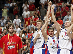 Spain's Pau Gasol, left, can only watch as Russian players (from left to right) Andrei Kirilenko, Petr Samoylenko and Nikita Morgunov celebrate their 60-59 victory in the European Basketball Championship title game.