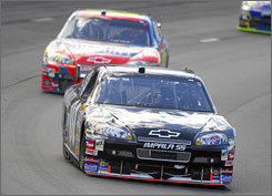 Clint Bowyer leads Jeff Gordon at the NASCAR Sylvania 300 at New Hampshire International Speedway.