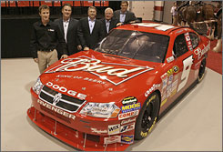 Kasey Kahne (from left), Anheuser-Busch execs Tim Schoen and Tony Ponturo, and team owners George Gillett and Ray Evernham unveil the No. 9 Bud entry for next season.