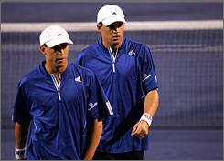 Bob, left, and Mike Bryan have teamed up to win 41 tournaments, including five Grand Slam events. Though a Davis Cup title is missing from their trophy case, they hope to change that this season.