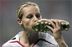 England's Kelly Smith, who kisses her shoe after each goal she scores, has done so four times thus far, tying her for the World Cup lead.