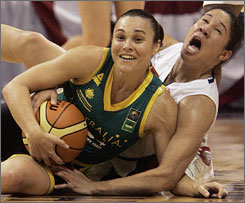 Australia's Tully Bevilacqua wins this battle for the ball against the United States' Kara Lawson during their exhibition. The Americans won 70-66 for their second win over the Australians in four days.