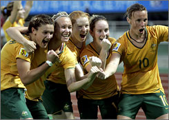 A late goal gave Australia a draw against Canada and earned a spot in the World Cup quarterfinals.