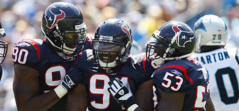 The Houston Texans have a core of young defensive stalwarts  including last year's No. 1 overall pick Mario Williams, left, and this year's first-round draft pick, Amobi Okoye, center, that has improved from 24th last season to ninth so far in 2007.