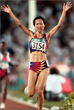 China's Junxia Wang hits the finish line to capture the women's 5000-meter race at the 1996 Atlanta Olympics.