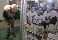 Ernie Trolio, an 81-year-old Brooklyn Dodgers fan, takes a look at team memorabilia inside a muesum at Keyspan Park at Coney Island.