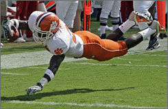 Clemson's C.J. Spiller dives into the end zone for a touchdown during the Tigers' 42-20 triumph over N.C. State on Saturday. The 13th-ranked Tigers are off to their best start since 2000 at 4-0.
