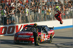Carl Edwards punctuates his victory in Sunday's 400-miler at Dover with his signature backflip celebration on the frontstretch.