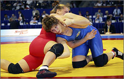 American Kristie Marano, in red, grapples with Bulgaria's Stanka Zlateva in the women's 72 kg final at the World Wrestling Championships in Azerbaijan on Sunday.