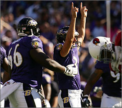 Ravens kicker Matt Stover celebrates after his game-winning field goal sailed through the uprights as time expired.